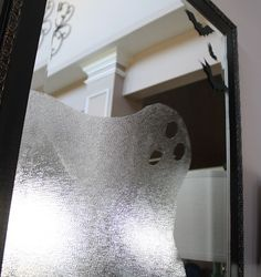 Ghost in the Mirror - Use press 'n' seal saran wrap to make a ghostly window - Click Pic for 27 DIY Halloween Decorating Ideas for Kids | #halloween #party #decorations