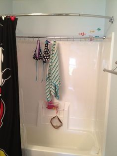 thought what a neat idea since we use our pool almost everyday in the warmer months. Just buy a shower rod, this one is a tension one and then I used the hooks to hang the curtain on, as hooks for the wet suits and towels instead. Pool Bathroom, Bathroom Storage, Small Bathroom, Rv Storage, Storage Ideas, Pool Towel Storage, Pool Towel Hooks, Bathroom Ideas, Landscaping