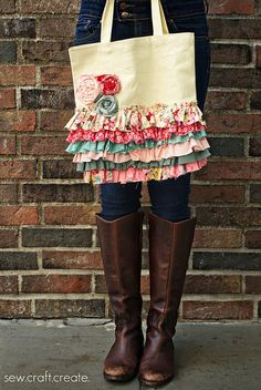 Such a cute idea...take a plain canvas bag, I would get thrift store little girl dresses with ruffles and sew onto the bag..make fabric roses...ADORABLE!