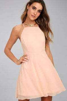 Lulus Exclusive! The Letter of Love Blush Pink Backless Skater Dress is our new obsession! Lightweight woven poly falls from adjustable spaghetti straps that crisscross at back, into a high, apron neckline. Fitted waist and flirty skater skirt. Elastic at back for fit, and hidden zipper/clasp.