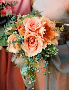 Bridal bouquet with peach roses and amaryllis with porcelain berries