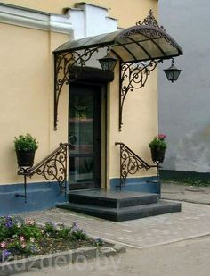 Welcoming wrought iron. House Entrance, Entrance Doors, Gate Design, Door Design, Front Door Awning, Wrought Iron Decor, Door Canopy, House Front Design, Grill Design