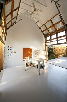 garage/studio, transparent roller doors on both sides for light, and can access backyard - genius!