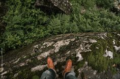 man in a leather boots stand in the nature area by Nikolay Bondarev for Stocksy United
