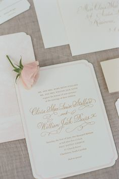 The couple's classic invitations were printed on white paper featuring a pink trim and elegant gold lettering. #weddingstationery #weddinginvitation Photography: Adrienne Page. Read More: http://www.insideweddings.com/weddings/pink-and-white-destination-wedding-in-charleston-south-carolina/542/