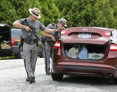 Gill searches the trunk of a vehicle in Malone, N.Y., Tuesday, June 23, 2015, while searching for two prison escapees from Clinton Correctional Facility. Police began focusing intensely on an area 20 miles west of the prison that inmates David Sweat and Richard Matt escaped from prison on June 6. (Jason Hunter/The Watertown Daily Times via AP) SYRACUSE OUT - © Provided by Associated Press