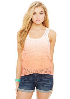 Hit the ombre trend in this sleeveless lace racerback tank with high-low hemline and two-tone color detail.