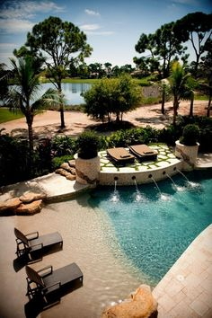 Beach entry, water feature, deck for sunning, pool design