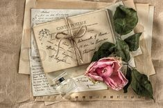 Stock image of 'old love letters, perfume and dried rose flower. nostalgic sentimental scrapbook paper background'