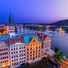 Old watertower and neighborhood from Old Town Tower of Charles bridge, Prague, Czechia Prague Old Town, Charles Bridge, Prague Czech, Top Travel Destinations, Travel Channel, Travel Videos, Water Tower, A Whole New World, Central Europe