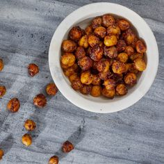 Roasting canned chickpeas until crispy makes a simple and healthy snack. In this riff on candied nuts, chickpeas are coated with cinnamon sugar to make them irresistible! This snack is best enjoyed the day it is made. Chickpea Snacks, Chickpea Recipes, Healthy Snacks, Healthy Recipes, Diet Snacks, Healthy Breakfasts, Healthy Kids, Eating Healthy, Dog Food Recipes