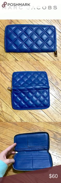 """Navy Blue Quilted Leather Marc Jacobs Wallet Beautiful navy blue quilted leather zip around wallet. Has space for 6 credit cards, a separate ID holder, plenty of room for cash and your phone (my iPhone 7 fit in with room to spare). Edges show wear but no piping is coming through, zipper and leather also show signs of use but overall in very good condition. Measures approx 7 1/2""""x4"""". Marc Jacobs Bags Wallets"""