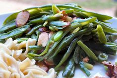 Instead of the traditional green bean casserole I'd do French Green Beans With Garlic and Sliced Almonds from Food.com:   This side or I would eat this as a snack. It has a garlicy, crisp, squeaky bite to it! Tossed with almonds. Use tender, young, thin beans.