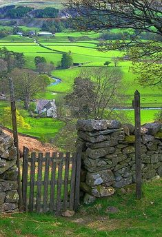 Countryside around Liverpool, England I'm a sucker for wood gates at stone wall passages. It's upsetting when they get walled up. This is so much friendlier.