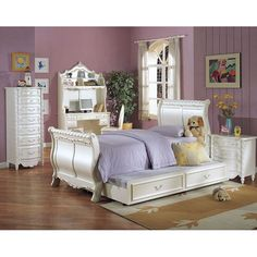 The perfect update for any growing girl's room, this lovely Pearl Collection twin sleigh bed is made with poplar wood and features beautifully intricate decorative carving. Featuring a lovely pearl finish, it is fit for a fairy-tale princess.