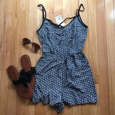 NWT Black and White Romper Super cute NWT black and white romper! Price tag has the wrong size on it, it is a size 2 (the only reason I'm selling it) has a strappy back and is perfect for summer! H&M Pants Jumpsuits & Rompers