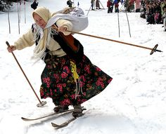 POLAND-SKI-OLD-EQUIPMENT,  A lady dressed in a 19th century outfit and using old wooden skis takes part in an old equipment, ski competition in Zakopane on April 13, 2009. Every Easter Monday the olden days ski competition is held in Kalatowki valley in the Tatra mountains near Zakopane. AFP PHOTO / JANEK SKARZYNSKI (Photo credit should read JANEK SKARZYNSKI/AFP/Getty Images)