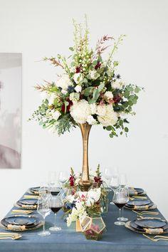 tall centerpiece - http://ruffledblog.com/art-gallery-inspired-wedding-shoot-with-agate