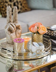 A mirrored tray looks right at home atop a mirrored coffee table.