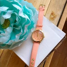 "Olivia Pratt Women's Petite Denim Watch- Coral This watch features a sleek colored dial that measures 1.25"" in diameter and is accented by gold tone bezel and markers. The timepiece is finished with a denim-print leather strap with a pin buckle closure. Quartz water-resistance: moisture and dust. Case: 31mm W x 31mm L x 6.25mm thick, strap: 19mm wide x 9"" long. Fits 6.5""-7.5"" wrists. NEE, NEVER BEEN WORN. Still has protective plastic over timepiece. NWT Olivia Pratt Accessories Watches"