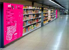 Spanish supermarket Sorli Discau has opened a QR Coded virtual store in Sarrià subway station in Barcelona. 400 products are available and are delivered to the shoppers home. QR Code poster shops at subway and railway stations are not new but what is interesting is that some virtual grocery stores are using QR Codes while others like Philadelphia's Peapod use UPCs and an app. The question is, in the long run which method will consumers prefer?