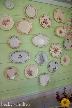 Vintage plates displayed on a green wall. Heartfelt and Homemade: Gooseberry Patch's Brand New Series
