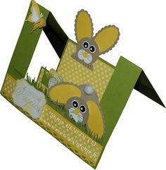 Hier après midi, je me suis amusée à créer une carte pour Pâques avec des lapins réalisés avec des perforatrices (punch art): La photo ne rend pas les vraies couleurs qui sont plus douces!. L'herbe est découpée tout simplement dans une bande de papier...