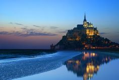 Mont Saint Michel, France  Lying on the Atlantic coast of north western France, Le Mont-Saint-Michel is a rocky cone-shaped islet in the Gulf of Saint Malo, connected only to the mainland via a causeway. The towering cluster of 13th century gothic architecture rises 73 metres above sea level, with the Benedictine Abbey Church standing as the village's central heart. One of the most spectacular sights is the village of Mont-Saint-Michel itself, with its coastal cafes, museums and quaint…