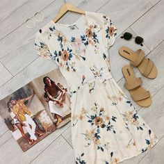 This Cream Floral Wrap Mini Dress is perfect for a warm-weather escape. #floralwrapdress #wrapminidress #yellowfloraldress #springdressoutfit