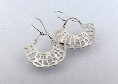 Half Shell Tribal Earrings with Hand Piercings in Satiny Sterling Silver
