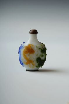 Peking Glass five colors overlaid dragons snuff bottle