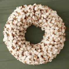 "This dried wreath of Gossypium, better known as a cotton, makes an unusual addition to indoor décor. Fluffy, stark white cotton balls surround the seed in each pod.- Dried cotton, Styrofoam wreath base- Indoor or sheltered outdoor use- Keep away from moisture- Imported5""D, 18.5"" diameter"