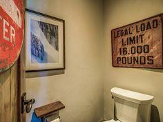 Fun with signs!  In this boys' bathroom in Southern Vermont ski house.  #vermontinteriordesign  #vermontbathroomdesign