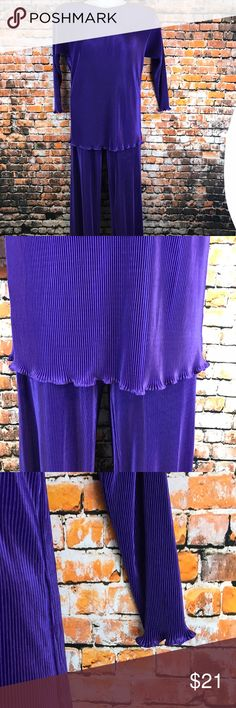 Womens Size Small Pant Set Vivid Purple Ribbed New without tags.  Women Size Small Pant Set. Elastic waist Pants.  Vivid purple.  Ribbed pattern.  Waist approximately 23 inches without stretching,  front rise approximately 13 inches and inseam approximately 29 1/2 inches. Made of 100% Polyester.  Dry Clean Only.  Natural ruffle hem.  Long Sleeves.  Tacked in shoulder pads.  Chest approximately 46 inches without stretching and length approximately 30 inches. Missing brand name tags. Other