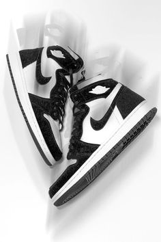 """The Women's Air Jordan 1 High """"Panda"""" effortlessly goes with anything in your wardrobe thanks to the clean and classic black and white color combo. The colorway may be simple, but the faux fur panels take things up a few notches in the style department."""