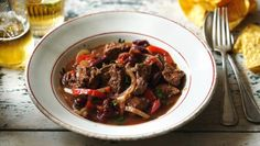 """""""Slow cooker chilli con carne: Chocolate added at the end gives a richness to this slow-cooked chilli. Delicious with soured cream, fluffy rice and a scoop of guacamole. Chilli Con Carne Recipe, Chilli Recipes, Beef Recipes, Uk Recipes, Savoury Recipes, Fish Recipes, Slow Cooker Beef, Slow Cooker Recipes"""