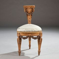 Straddled by a gentleman watching a card game or other entertainment, this 19th-century gilt-wood voyeuse in the Louis XVI style is a near-replica of a 1768 Flamande chair by architect Jean-Charles Delafosse. It once stood before the fireplace of the Salon Bleu of the Lopez-Willshaws' house in Neuilly-sur-Seine.