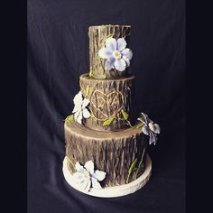 This woodland garden themed cake with Clematis flowers was designed by the bride and brought to life by Kendall at Short North Piece of Cake. Reception held @denmarkonhigh in their North Room space! #cake #cakeart #columbusweddings #columbuswedding #asseenincolumbus #denmarkonhigh #shortnorth #flowers #tree
