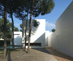 Built by Jorge Mealha in Miranda do Corvo, Portugal For the surrounding ground, a set of virtually blank solids perform a dialectically tensioned play, searching, throug...