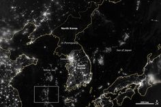 The difference in the development between the North and South Korea.  There is more light in the Yellow Sea (small square)    http://earthobservatory.nasa.gov/Features/IntotheBlack/images/korea_vir_2012268.jpg