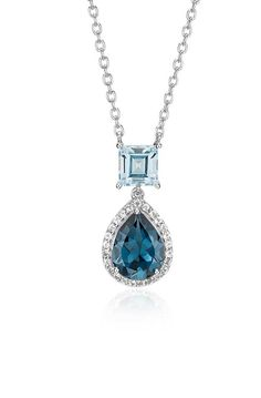 Let vibrant color take center stage with this blue and London blue topaz pendant, featuring a complementing halo of white topaz gemstones.