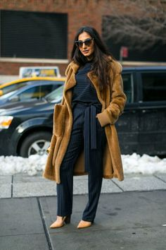Wool trench coat styled with an all black jumper