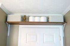Install a shelf over the door
