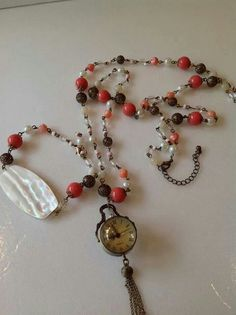Mother of pearl bracelet , and watch necklace by: Nina Fontana