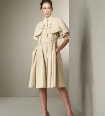 Coat Dress: a dress styled like a coat usually with a front buttoning from neckline to hemline.