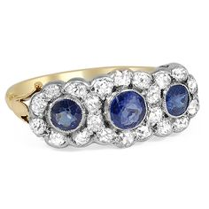 The Manica Ring from Brilliant Earth circa 1880's A beautiful example of Victorian-era artistry, this romantic ring features three round natural sapphires in milgrain-embellished bezel settings. All are encircled by glittering diamond accents to create a feminine floral design (approx. 0.66 total carat weight).