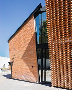 Exterior, Gable RoofLine, House Building Type, Brick Siding Material, and Metal Roof Material The entrance door is made of mirror-like glass to enhance privacy. Brick Roof, Brick Siding, Metal Roof, Modern Exterior, Exterior Design, Red Brick Exteriors, Gable Roof Design, Brick Material, Brick Art