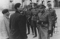 SS and Police Leader Juergen Stroop interrogates two Jews arrested during the Warsaw ghetto uprising. Poland, April 19-May 16, 1943.