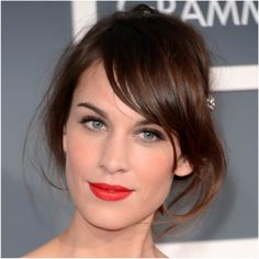 Alexa Chung. She can seriously do no wrong. Side swept bangs, simple eyes and a pop of red!