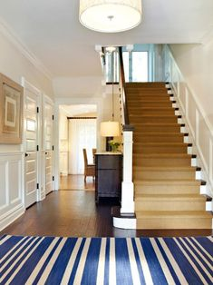 Dutch colonial homes, entry hallway, bright hallway, entryway stairs, front Foyer Design, Hall Design, House Design, Staircase Design, Coastal Color Palettes, Coastal Colors, Entryway Stairs, Entry Foyer, Wood Stairs